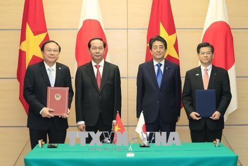 越南国家主席陈大光与日本首相安倍晋三举行会谈 hinh anh 3