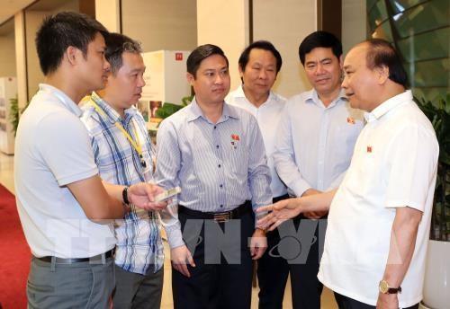 第十四届国会第五次会议:政府总理愿意倾听针对《特别行政经济单位法案》的意见 hinh anh 1