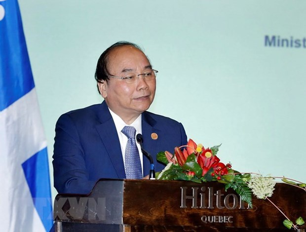 政府总理阮春福出席越加企业座谈会 hinh anh 1