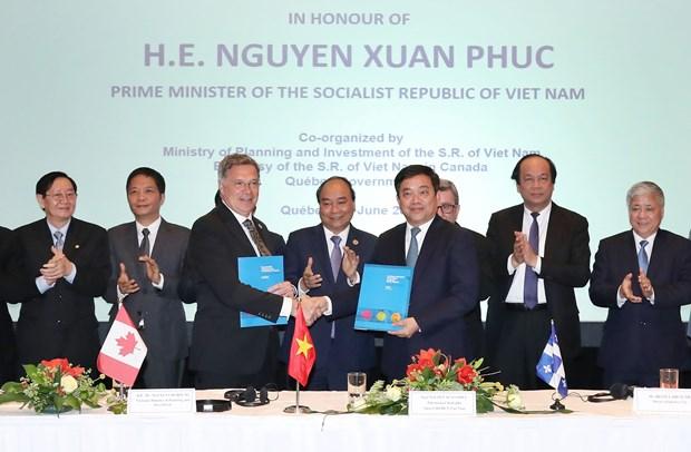 阮春福出席越南与加拿大企业座谈会 hinh anh 1