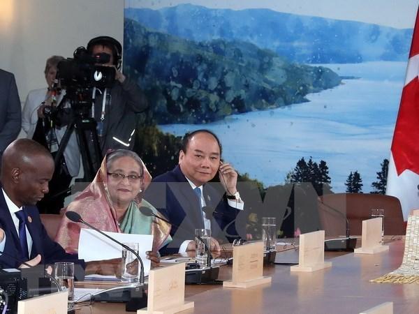加拿大媒体:越南出席G7峰会扩大会议为建立越加经济和地缘战略关系提供机会 hinh anh 1