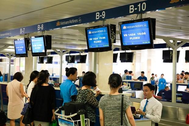 越航要求乘客提早抵达机场办理乘机手续以免误机 hinh anh 1