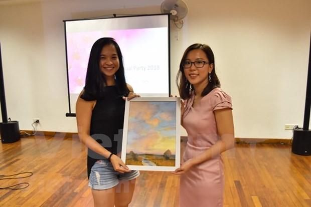 数百名越南优秀贫困学生荣获新加坡兰花奖学金 hinh anh 1
