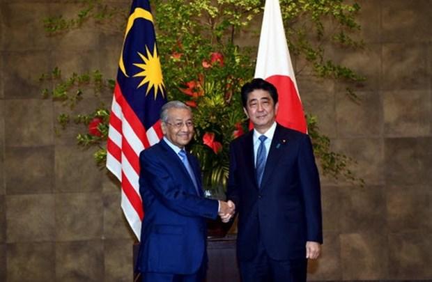日本与马来西亚承诺在朝鲜问题上加强合作 hinh anh 1