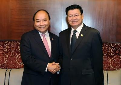 阮春福同老挝政府总理通伦·西苏里举行会谈 hinh anh 1