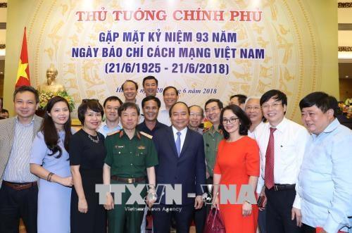 政府总理阮春福: 把握新媒体技术和新闻报道新方式 hinh anh 1
