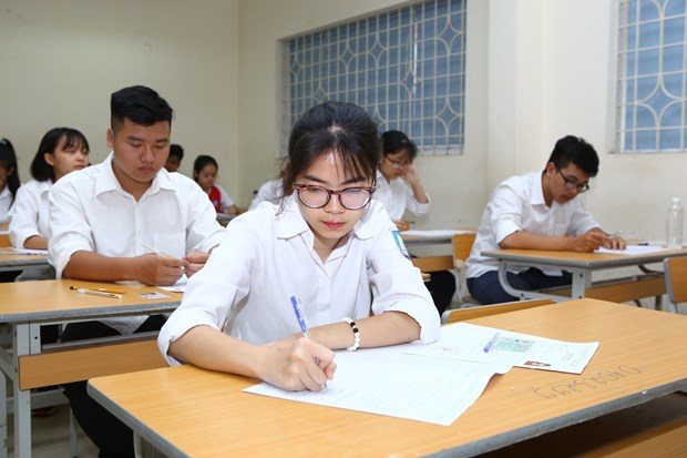 2018年越南国家高中毕业和大学入学统一考试正式开考 报考人数约90万 hinh anh 1