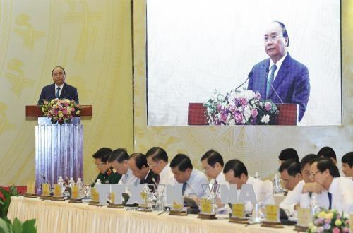 政府总理阮春福主持召开政府与各地方视频会议 hinh anh 2