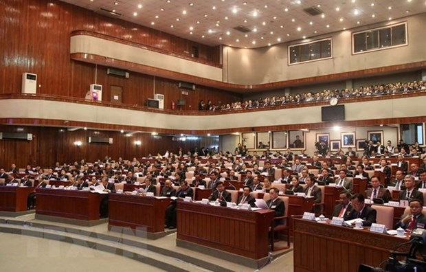 老挝第8届国会第5次会议闭幕并通过13部法案 hinh anh 1