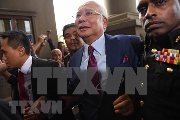马来西亚前总理纳吉布今日出庭受审 hinh anh 1