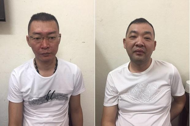 越南广宁省公安向中国移交两名通缉犯 hinh anh 1