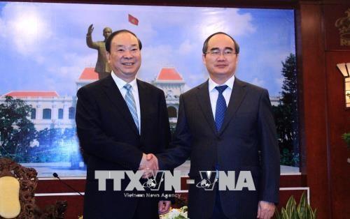 胡志明市领导会见中国共产党代表团 hinh anh 1