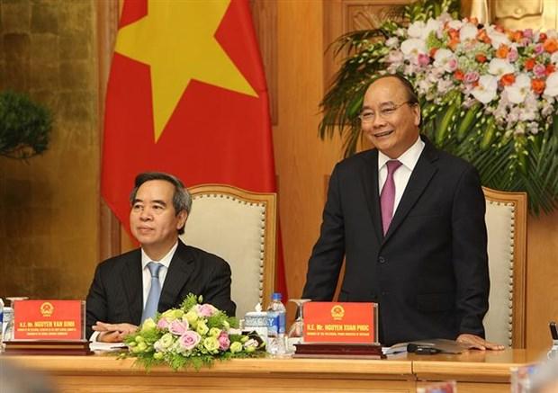 政府总理阮春福会见出席2018年工业4.0峰会的演讲者和企业代表 hinh anh 2