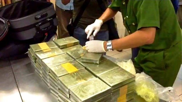 越南公安破获跨境贩毒案 缴获179块海洛因砖 hinh anh 1