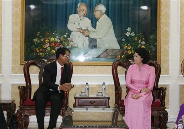 胡志明市与老挝占巴塞省加强阵线工作经验交流 hinh anh 1