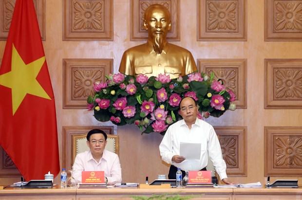 越南政府总理阮春福出席国家货币与财政政策咨询委员会会议 hinh anh 1