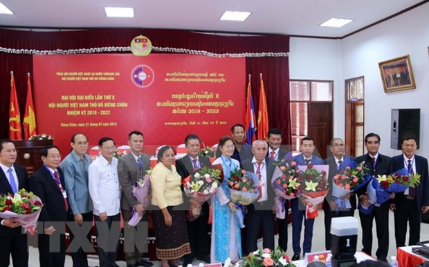 老挝万象越南人协会第十届代表大会成功举办 通过协会章程修正版 hinh anh 1