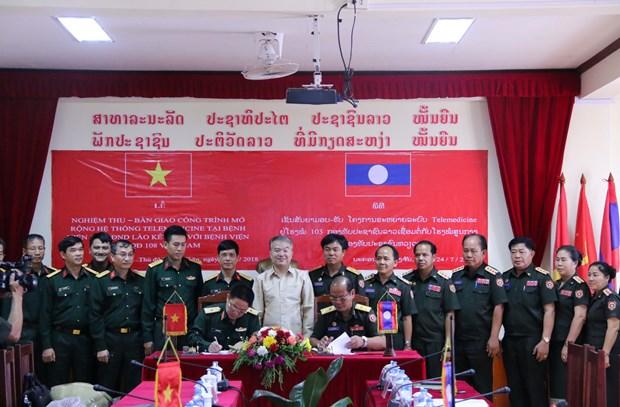 越南军队帮助老挝军队提高远程门诊医疗质量 hinh anh 2