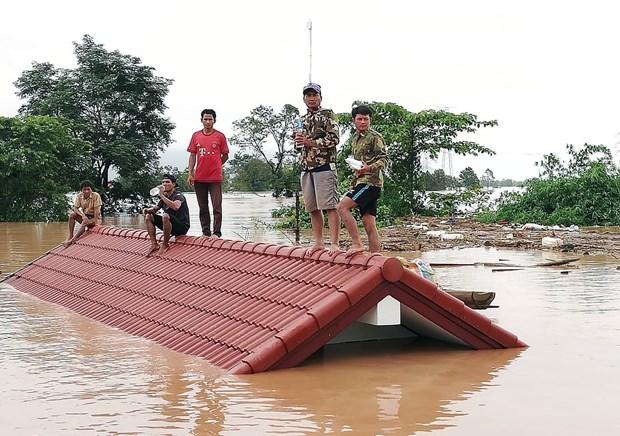 老挝一水电站大坝坍塌 越南领导人为此致慰问电 hinh anh 1