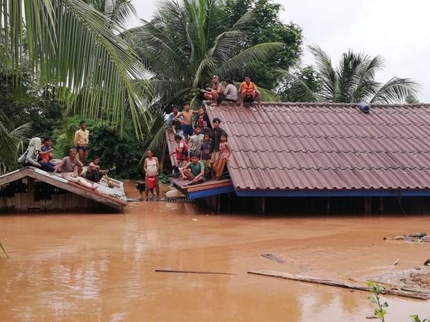 老挝水电站大坝坍塌事故:黄英嘉莱公司努力将26名工人撤出灾区 尚未有越南公民伤亡报告 hinh anh 1