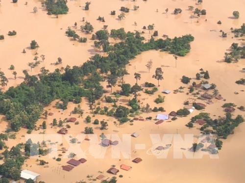 老挝一水电站大坝坍塌致19人死亡 韩国总统文在寅派救援队赴现场 hinh anh 1