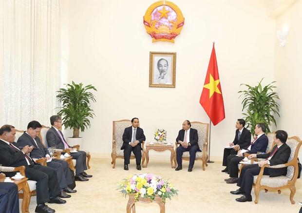 越南政府总理阮春福会见老挝监察总署总监察长本通•吉马尼 hinh anh 2