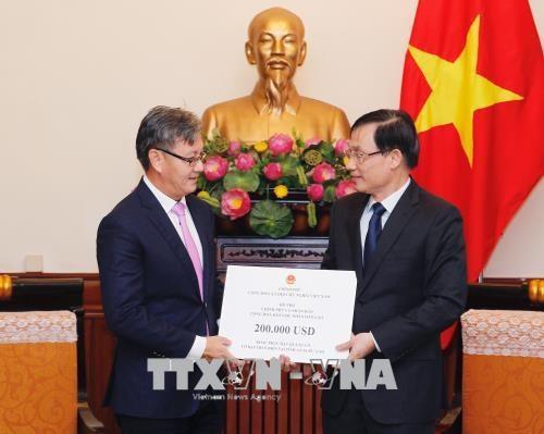 老挝水电站大坝坍塌事故:越南政府向老挝提供20万美元的救灾援助 hinh anh 1
