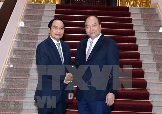 越南政府总理阮春福会见老挝监察总署总监察长本通•吉马尼 hinh anh 1
