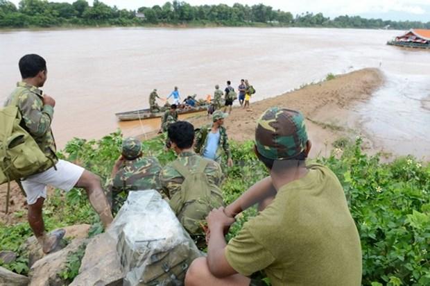 老挝水电站大坝坍塌事故:努力寻找失踪人员 hinh anh 1