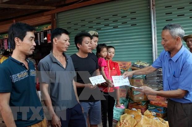 越南继续向老挝一水电站大坝坍塌受灾群众提供援助 hinh anh 2