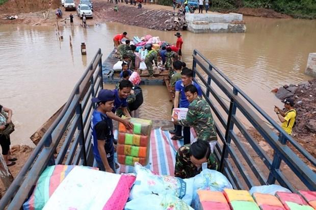 越南继续向老挝水电站大坝坍塌事故受灾群众提供援助 hinh anh 1