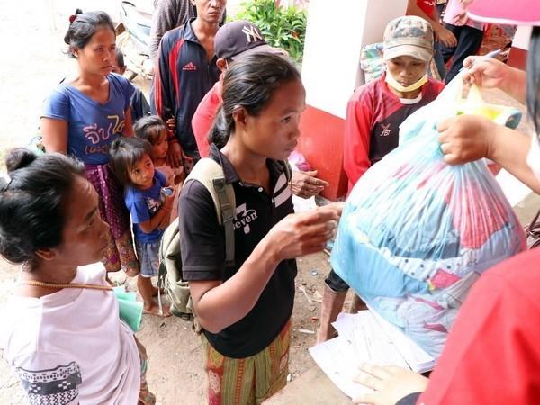 老挝水电站大坝坍塌:泰国政府呼吁人民为灾民提供援助 hinh anh 1