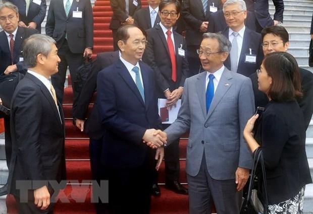 越南国家主席陈大光会见日越经济委员会代表团 hinh anh 1