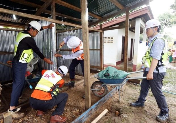 老挝水电站溃坝事件 :韩国SK工程及建筑公司为灾民兴建临时住宅 hinh anh 1