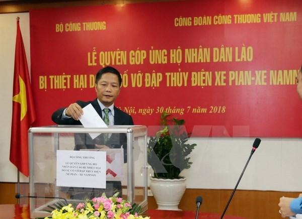 老挝水电站大坝坍塌事故:向老挝灾民伸出援手 hinh anh 1