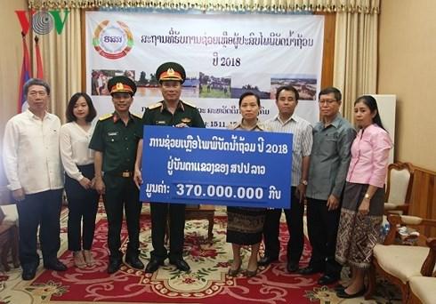 老挝水电站大坝坍塌事故:越南国防部11号兵团向老挝灾民提供援助 hinh anh 1