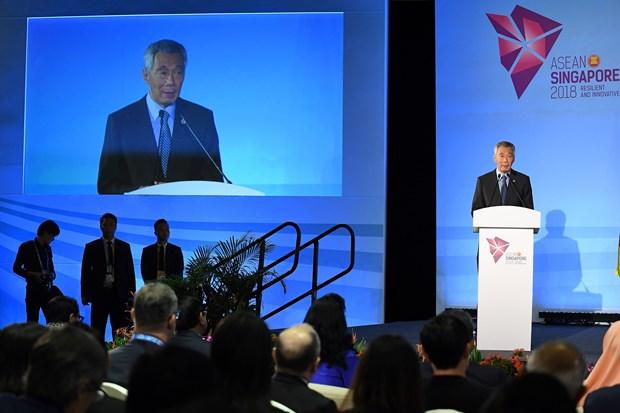 新加坡总理李显龙:东盟应共同释放承诺贸易自由化与经济一体化的明确信号 hinh anh 1
