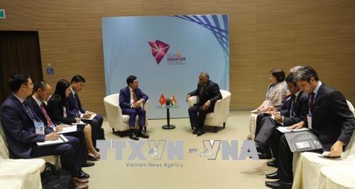 第51届东盟外长会议:越南政府副总理兼外长范平明会见印度、文莱和菲律宾外长 hinh anh 1