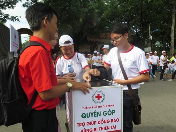 胡志明市5千多人参加为橙剂受害者和贫困残疾人步行筹款活动 hinh anh 2