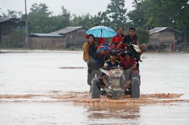 老挝水电站溃坝事故:越南国防部向老挝提供5万美元的援助资金 hinh anh 1
