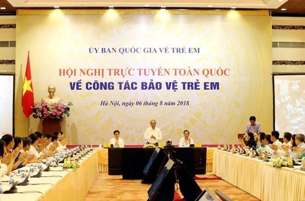 政府总理阮春福主持召开全国儿童保护工作视频会议 hinh anh 1