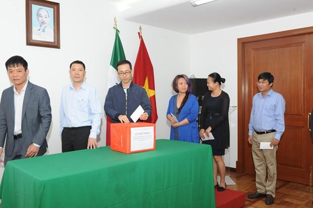 旅居墨西哥越南人为老挝水电站大坝坍塌受灾群众提供援助 hinh anh 1
