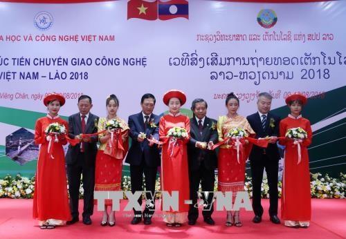 2018年越老技术转让促进论坛在老挝开幕 hinh anh 1