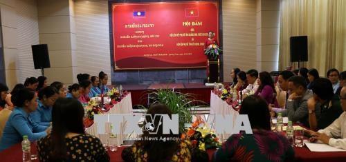 越南广南同老挝色贡两省妇女协会加强经验交流合作 hinh anh 1