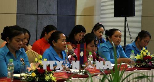越南广南同老挝色贡两省妇女协会加强经验交流合作 hinh anh 2