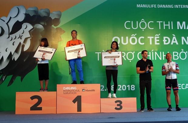 2018年岘港国际马拉松赛:越南运动员在三个赛项夺得冠军 hinh anh 1