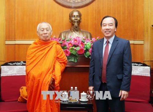 越南与老挝两国佛教协会加强合作增进交流 hinh anh 1
