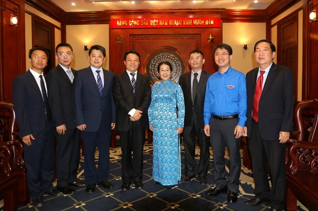 胡志明市领导人会见中国共青团中央高级代表团 hinh anh 1