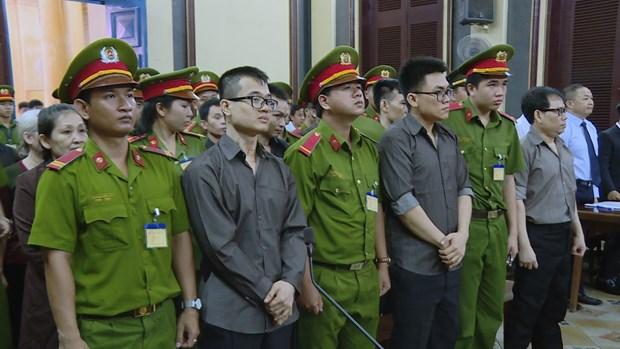 """涉嫌""""颠覆国家政权罪""""的""""临时越南国家政府""""反动组织成员出庭受审 hinh anh 2"""