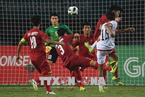 ASIAD 2018:越南国家奥林匹克足球队挺进1/4决赛引发东南亚媒体轰动 hinh anh 1